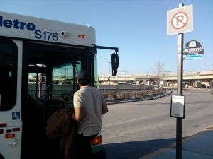 Passenger boards southbound Route 129 bus to Downtown Kansas City.