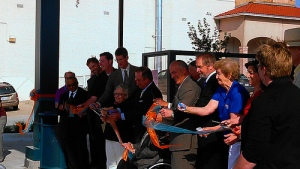 Elected officials cut the ribbon to dedicate the new Allen Roth Transit Center in Mission, Kansas. July 1, 2013.