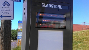 Real-time arrival sign at Southbound Gladstone Route 142 stop, 70th and North Oak. The display is working, it's just that our camera speed is too fast to capture it.
