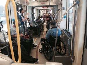 Our streetcar will work like this-1. bikes roll on and owners control them (see bike in middle of picture)- 2. wheelchairs roll on, find their designated location and LOCK WHEELS (no tie down). Picture from San Diego Trolley (light rail)